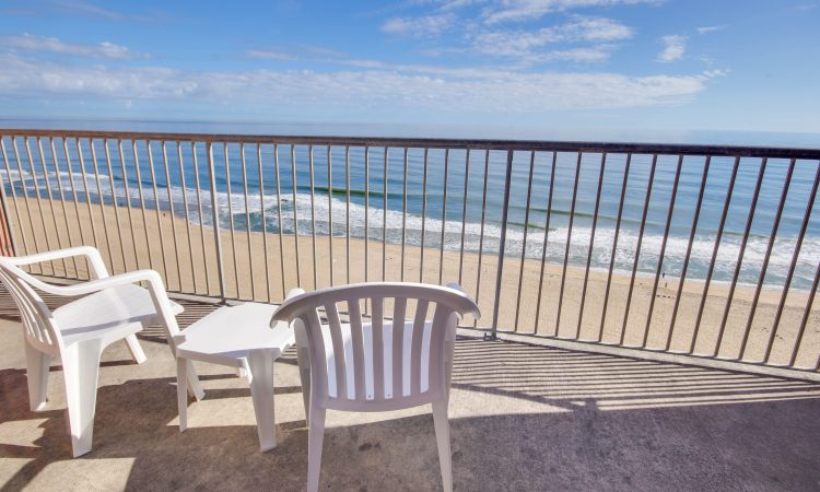 deck with ocean view and chair