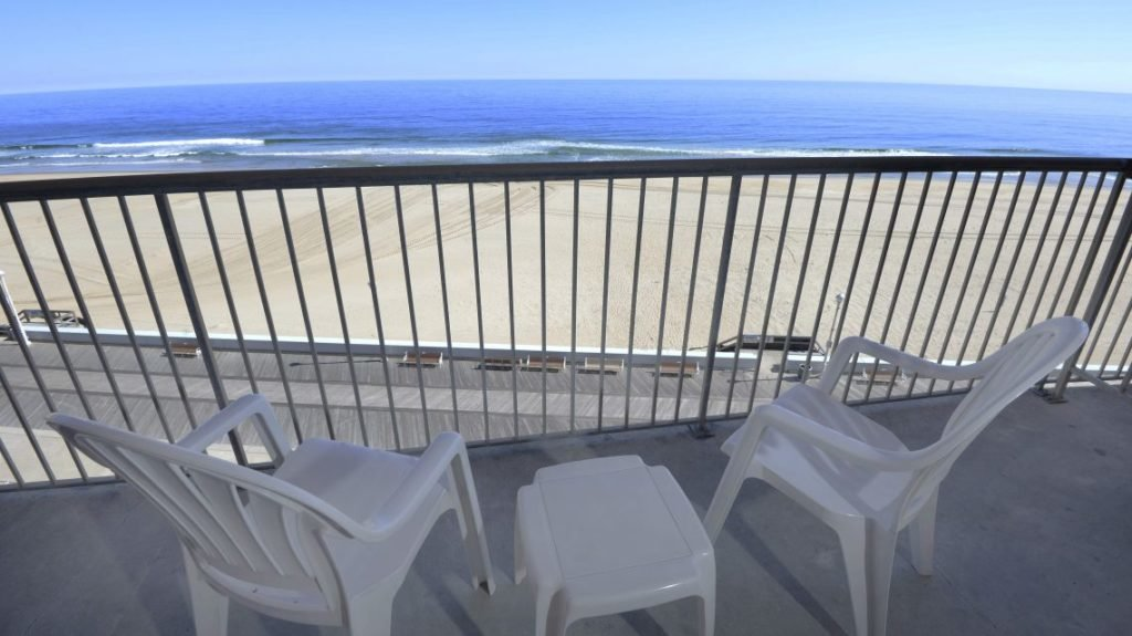 oceanview balcony with tables and chairs