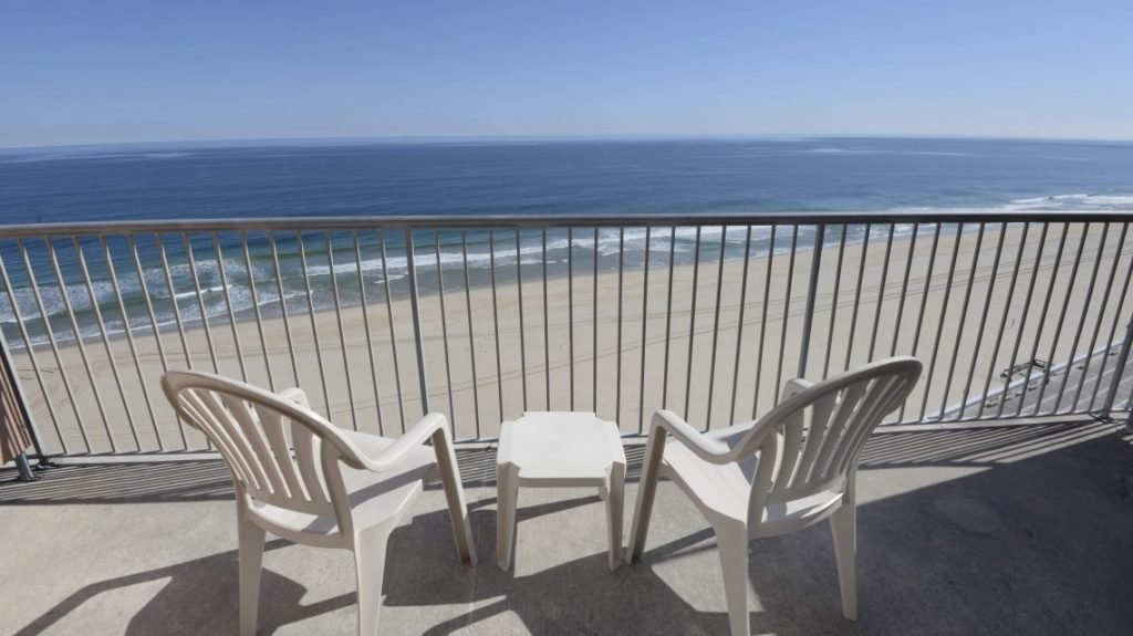 balcony view with tables and chairs