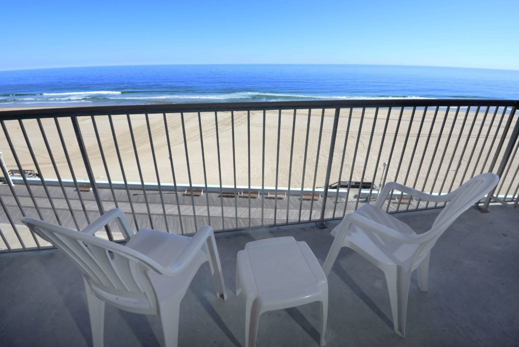 oceanfront balcony with table and chairs