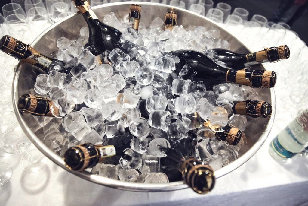 bottles of champagne in bucket of ice