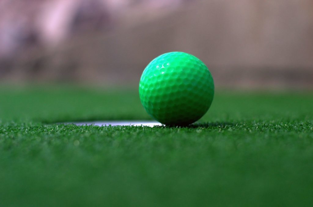 close up of green golf ball on green
