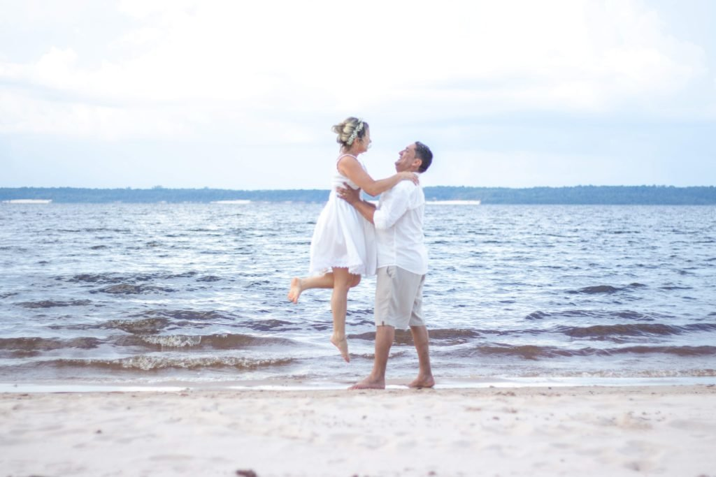 female and male couple on beach for wedding