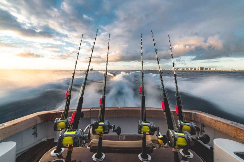 fishing rods on boat in ocean