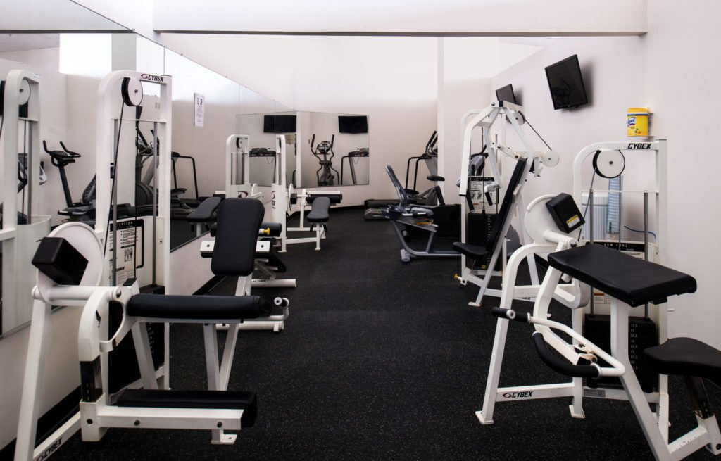 gym with weight machines and tvs