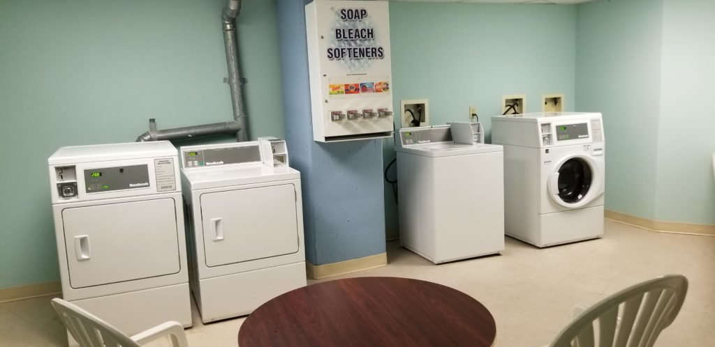 hotel laundry room with washers and dryers