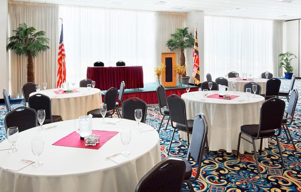 hotel meeting room with tables and chairs
